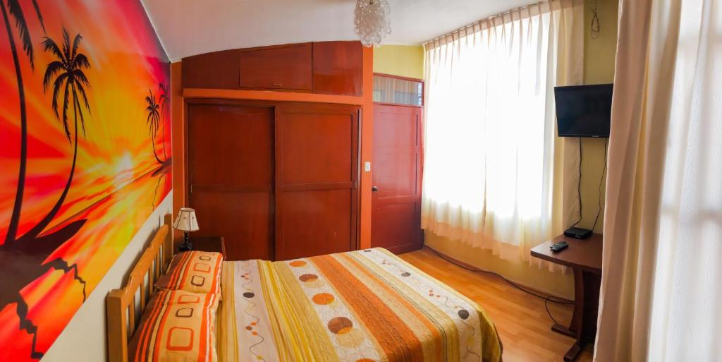 A bed or beds in a room at Hospedaje Virma