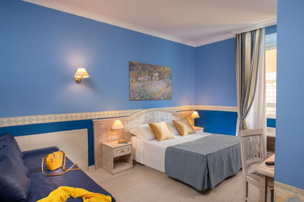 A bed or beds in a room at Piccolo Imperiale