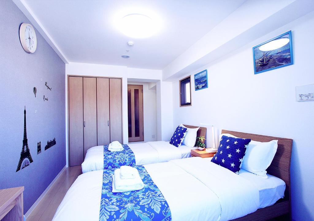 เตียงในห้องที่ Uihome Five Star Kujyo Hotel