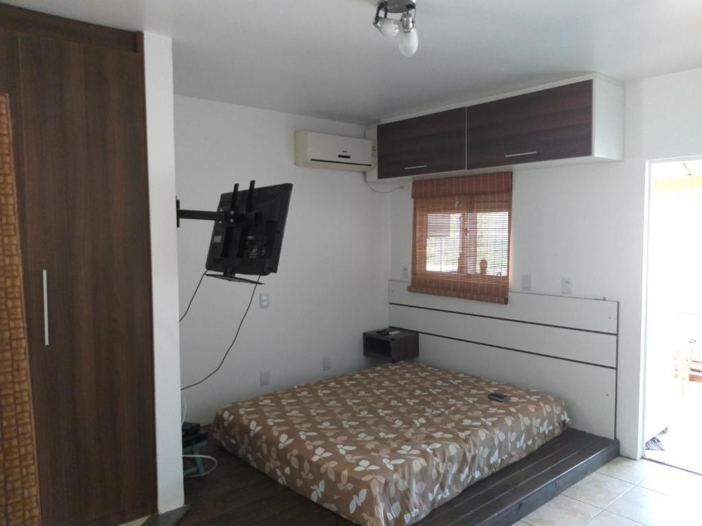 Cama o camas de una habitación en Loft Canasvieiras 50 m da praia