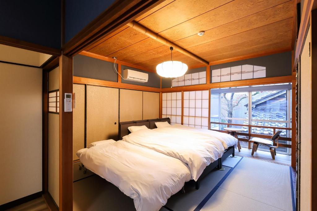 TAMACO in Kanazawaにあるベッド