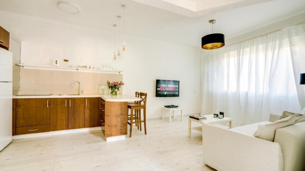 A cozinha ou cozinha compacta de Double O - Boutique apt Next to Beach