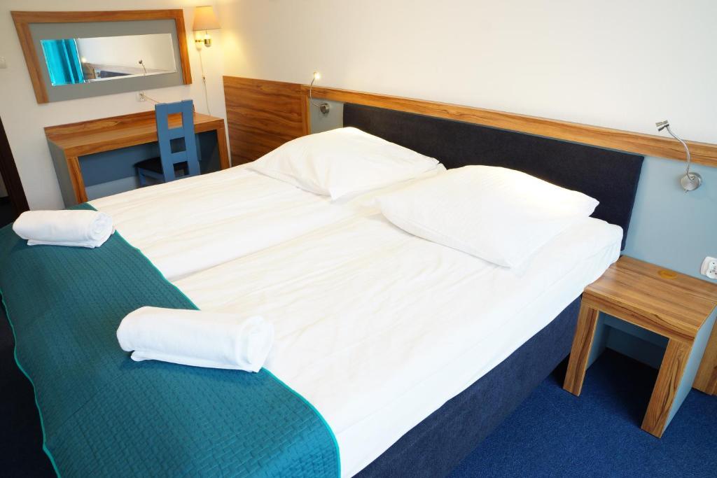 Łóżko lub łóżka w pokoju w obiekcie Dom Wczasowy Jawor