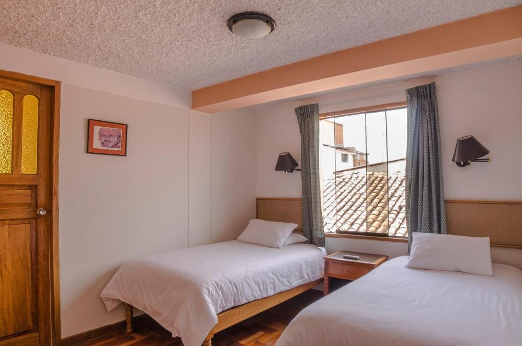 Cama o camas de una habitación en Los Aticos B&B