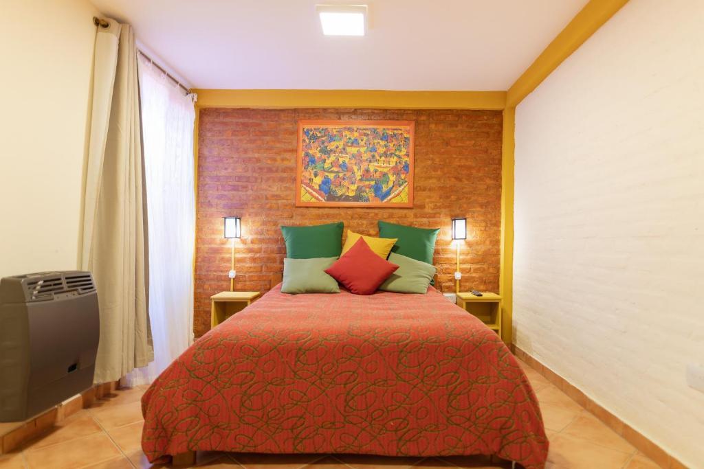 Una cama o camas en una habitación de Samaná Departamentos