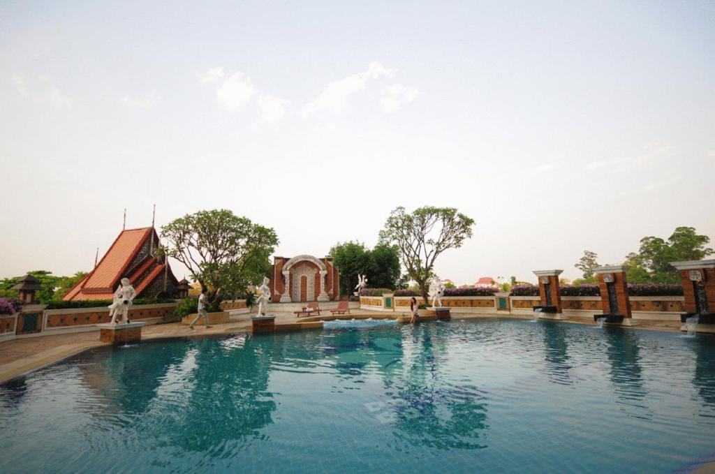 The swimming pool at or near Furama Chiang Mai