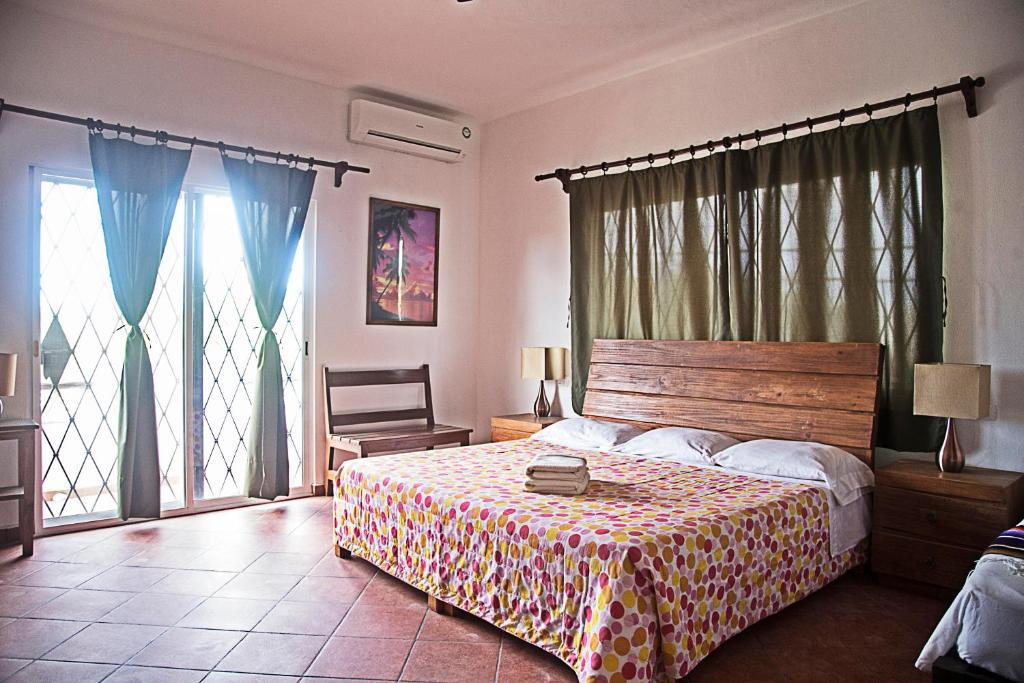 A bed or beds in a room at Posada Giana