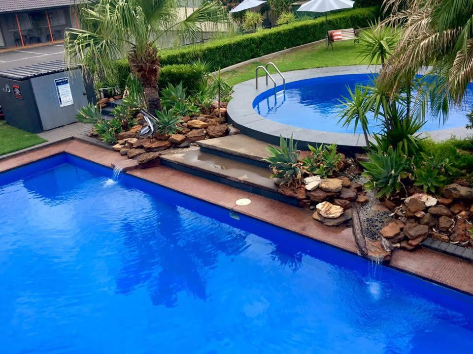 The swimming pool at or near Country Leisure Motor Inn