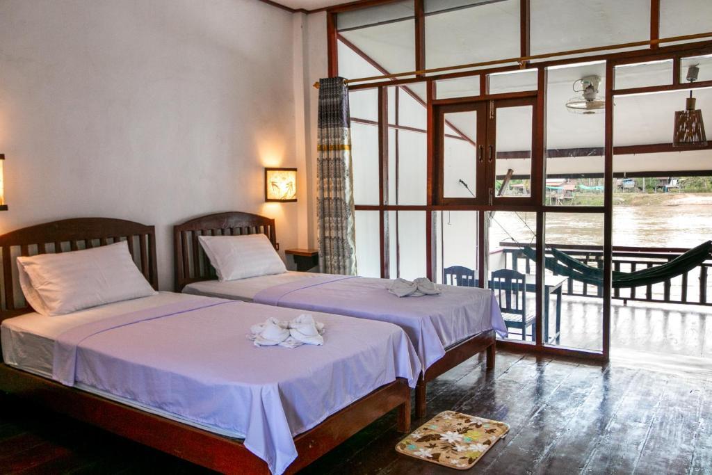 Un ou plusieurs lits dans un hébergement de l'établissement Dokchampa Guesthouse