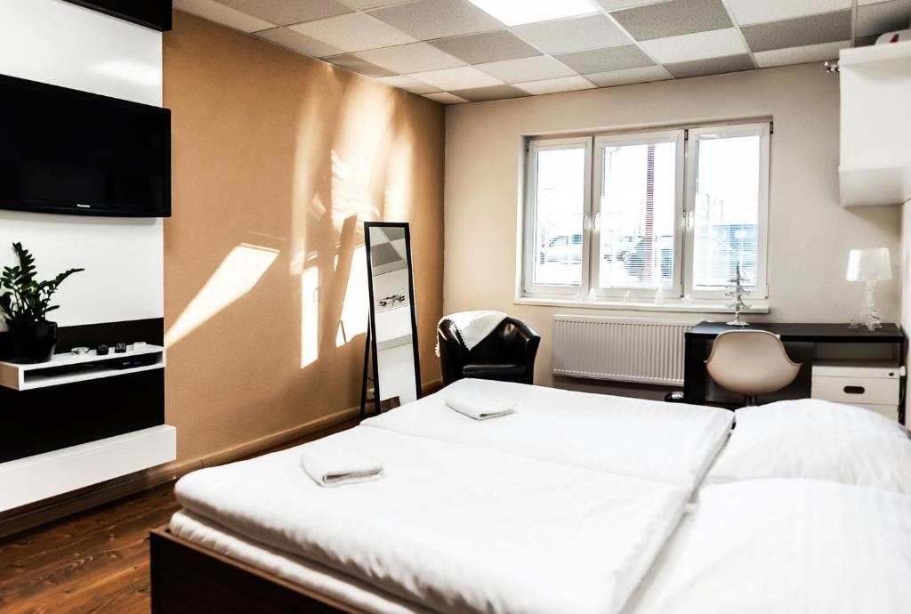 Posteľ alebo postele v izbe v ubytovaní AeroCafe