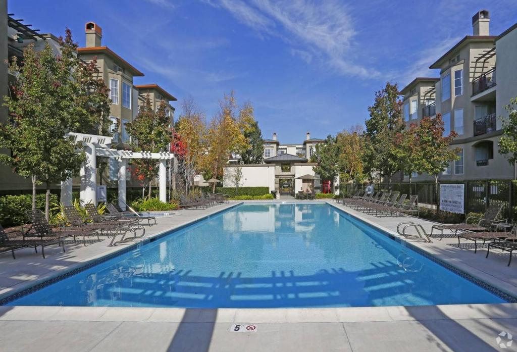 The swimming pool at or near Enclave Luxury Apartments 2 - #121