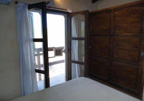 Una cama o camas en una habitación de Cabañas Los cantaros del rio