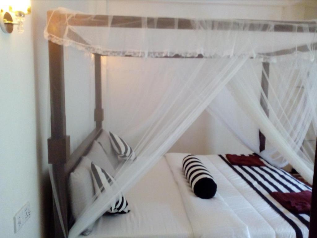 Ein Bett oder Betten in einem Zimmer der Unterkunft Forest Paddy Homestay