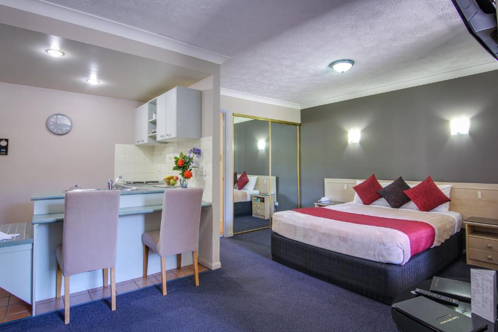 Lova arba lovos apgyvendinimo įstaigoje AAA Airport Albion Manor Apartments and Motel