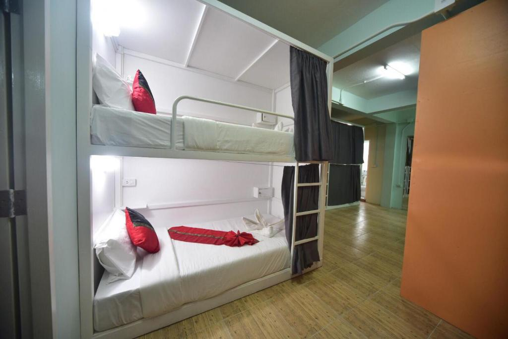 A bunk bed or bunk beds in a room at Panda Hostel Phuket