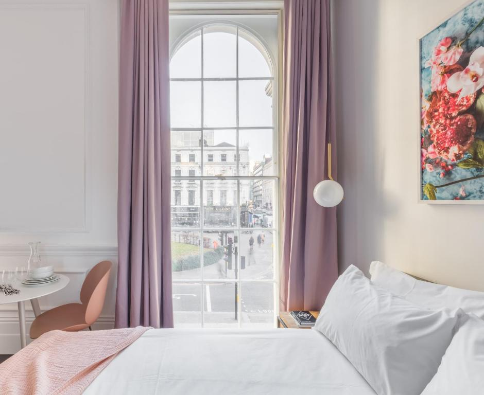 Ein Bett oder Betten in einem Zimmer der Unterkunft The Moorgate