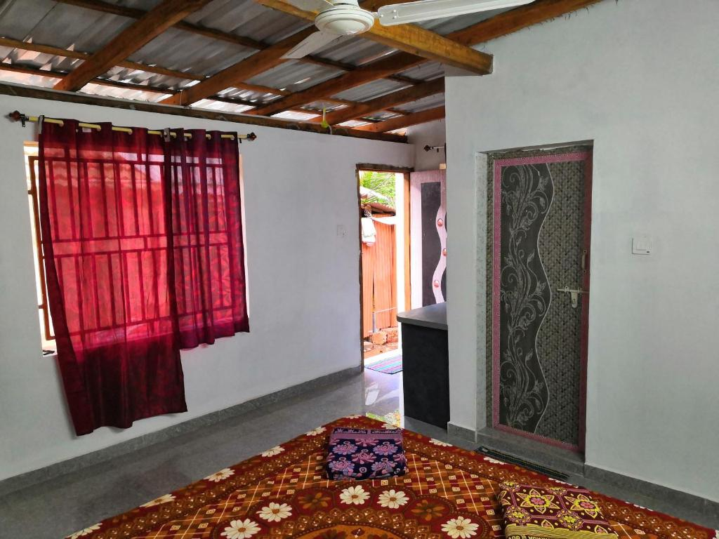 A bed or beds in a room at krishna soori garden house
