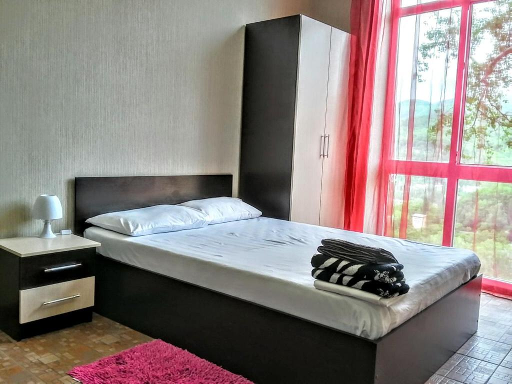 A bed or beds in a room at Apartments Sukhumskie