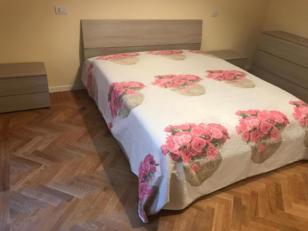 A bed or beds in a room at Appartamento signorile