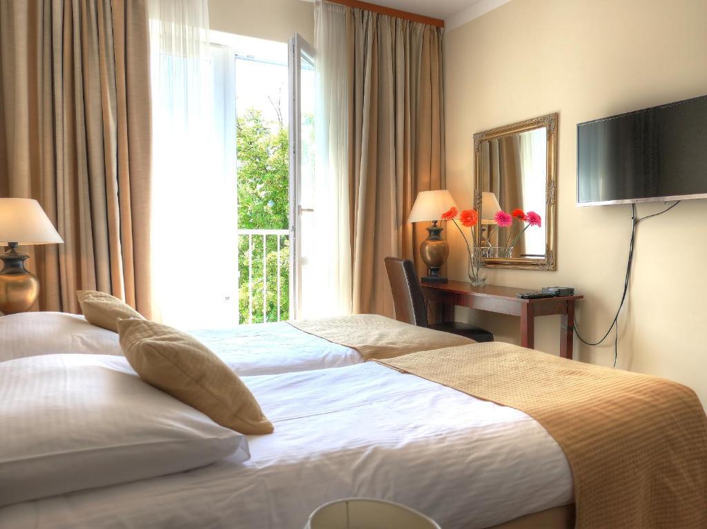 Ένα ή περισσότερα κρεβάτια σε δωμάτιο στο Apartment on Dalimilova 12