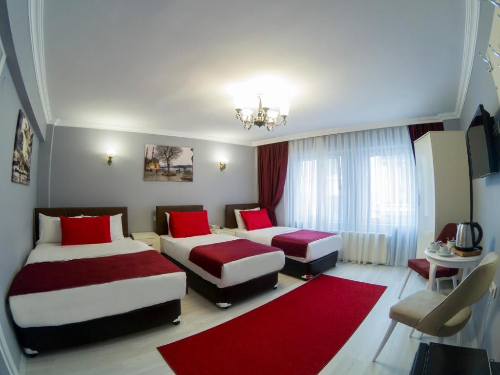 Кровать или кровати в номере Sirkeci Family Hotel