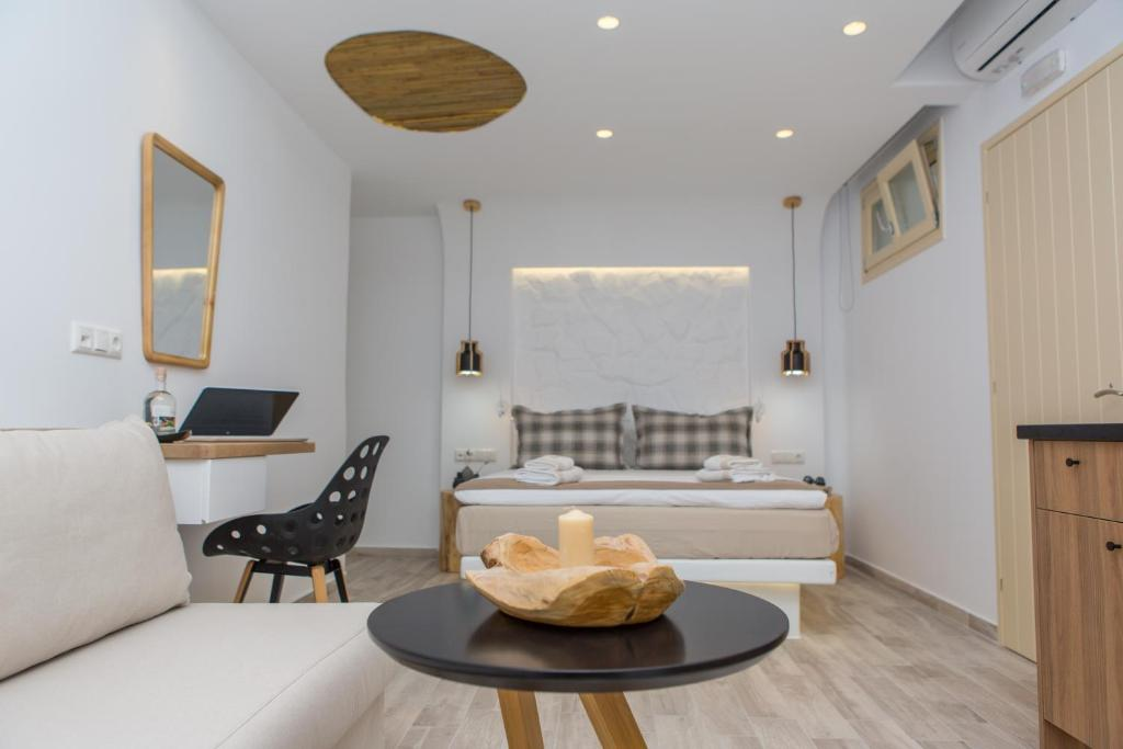 A bed or beds in a room at Korali Boutique Hotel