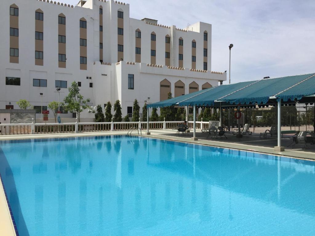 The swimming pool at or near Hotel Al Madinah Holiday