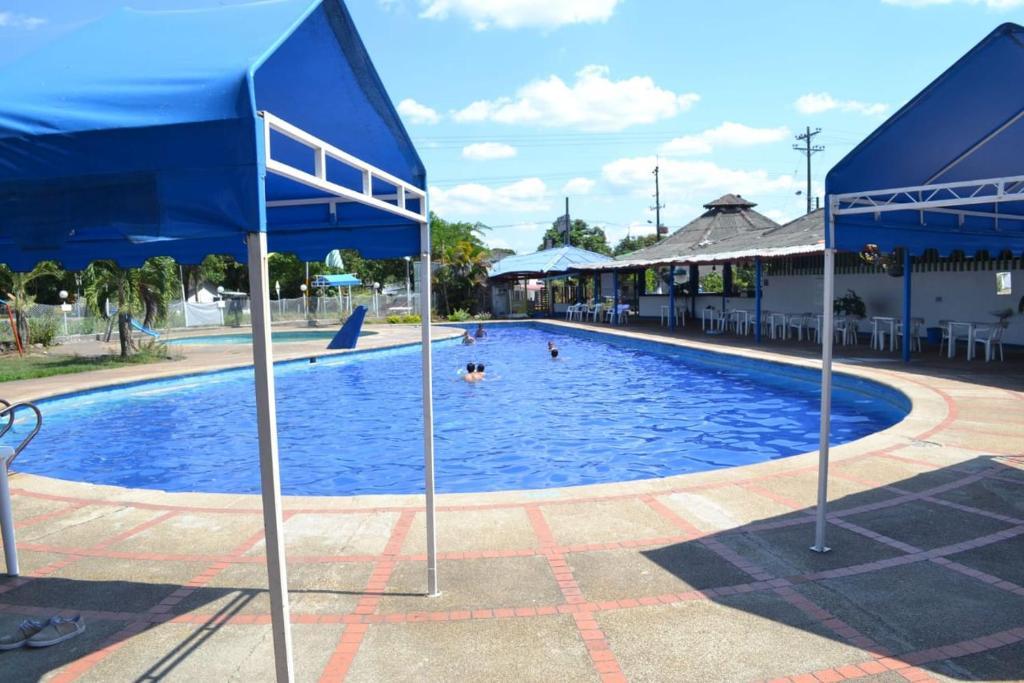 The swimming pool at or near Hotel Paraíso del Llano