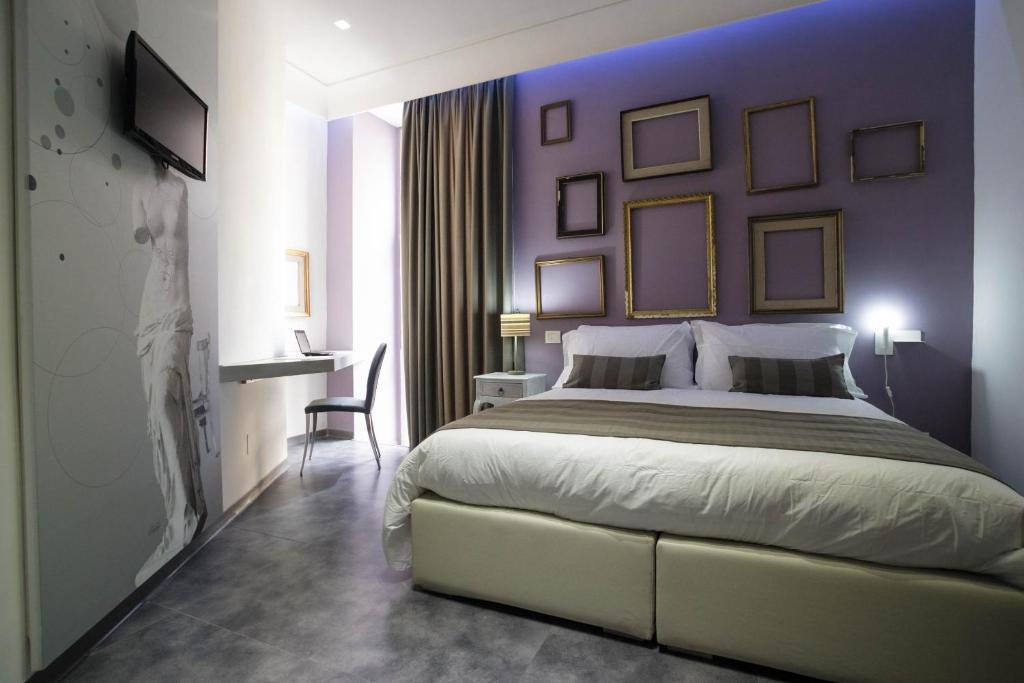 Cama o camas de una habitación en Hotel Santa Brigida