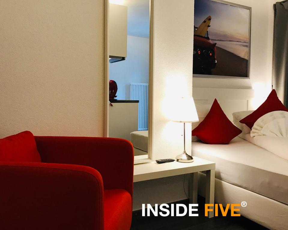 A seating area at INSIDE FIVE City Apartments