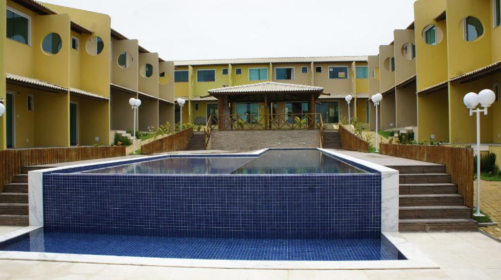A piscina localizada em Village Imbassai Flat ou nos arredores