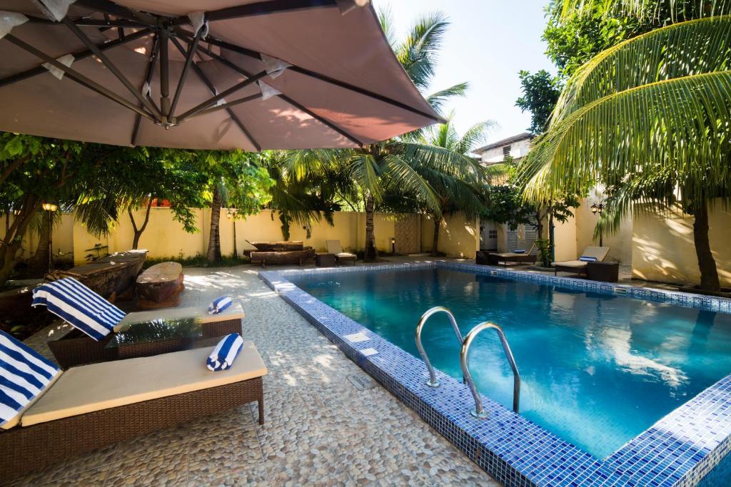 The swimming pool at or near Antonio Garden Hotel