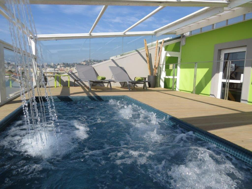 The swimming pool at or near Hôtel Riva Art & Spa