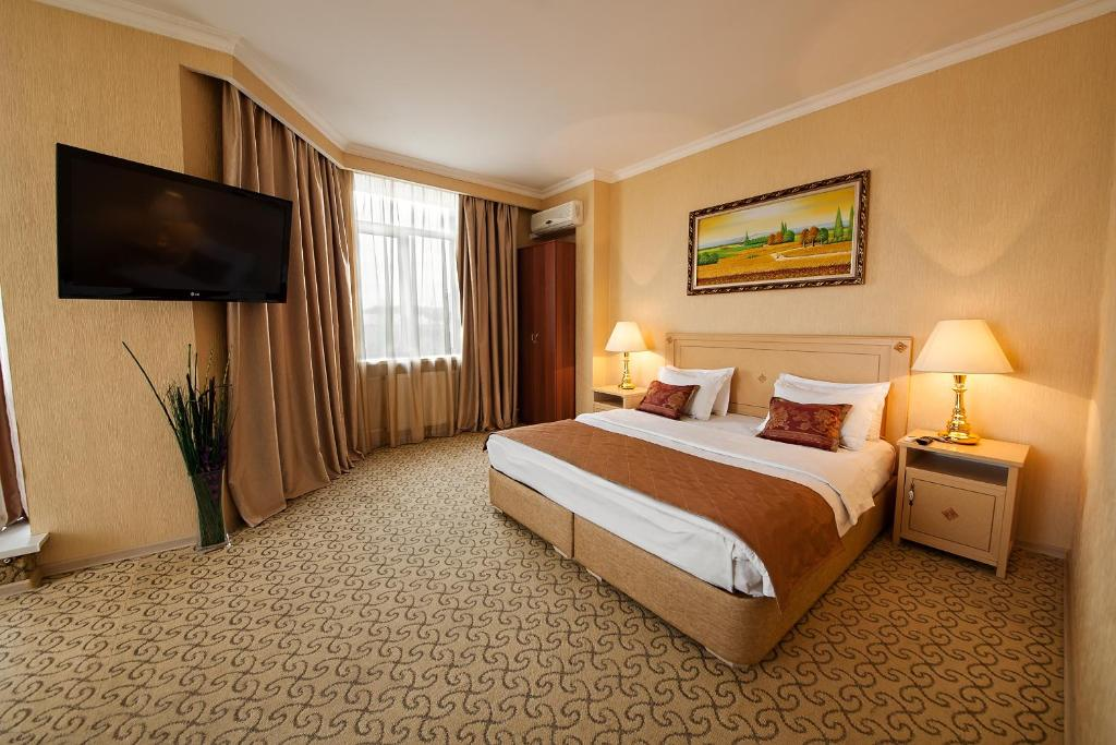A bed or beds in a room at Vnukovo Village Guest House & SPA