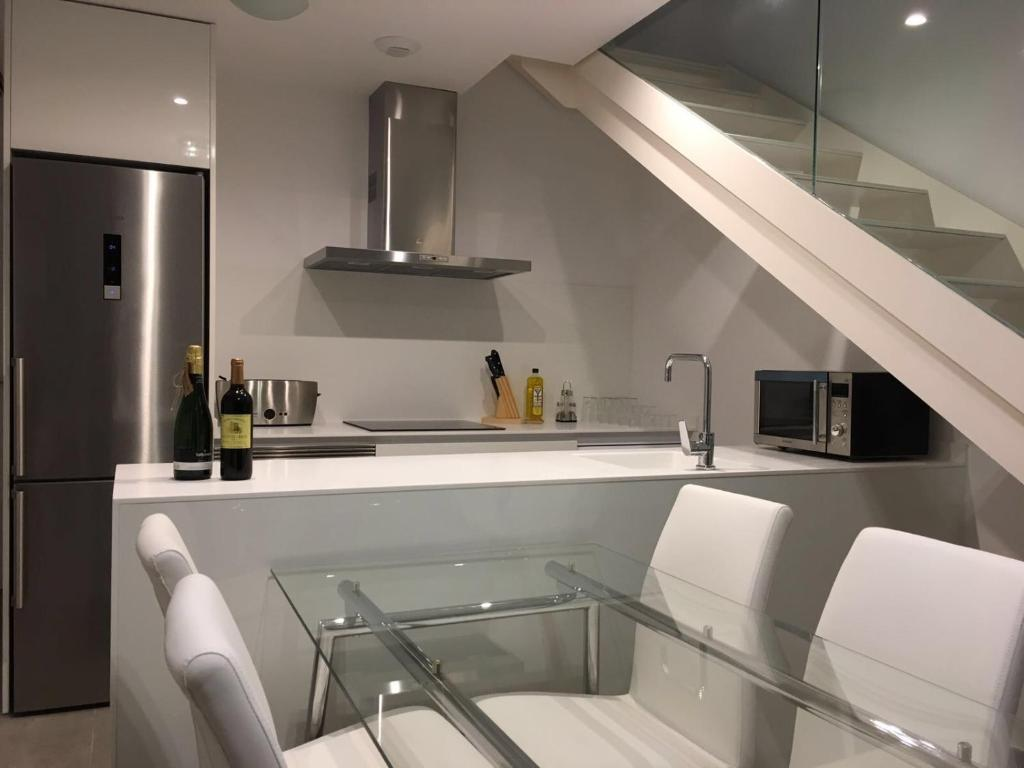 A kitchen or kitchenette at Stylish Stay by TP Apartments