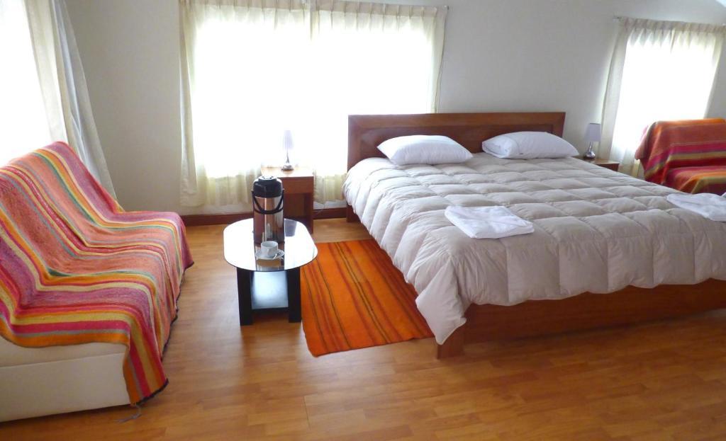 Cama o camas de una habitación en Cusco Home Hotel