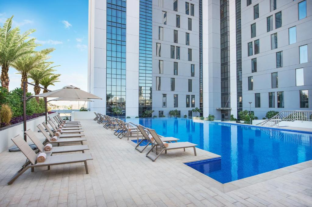 The swimming pool at or near Hampton By Hilton Dubai Airport