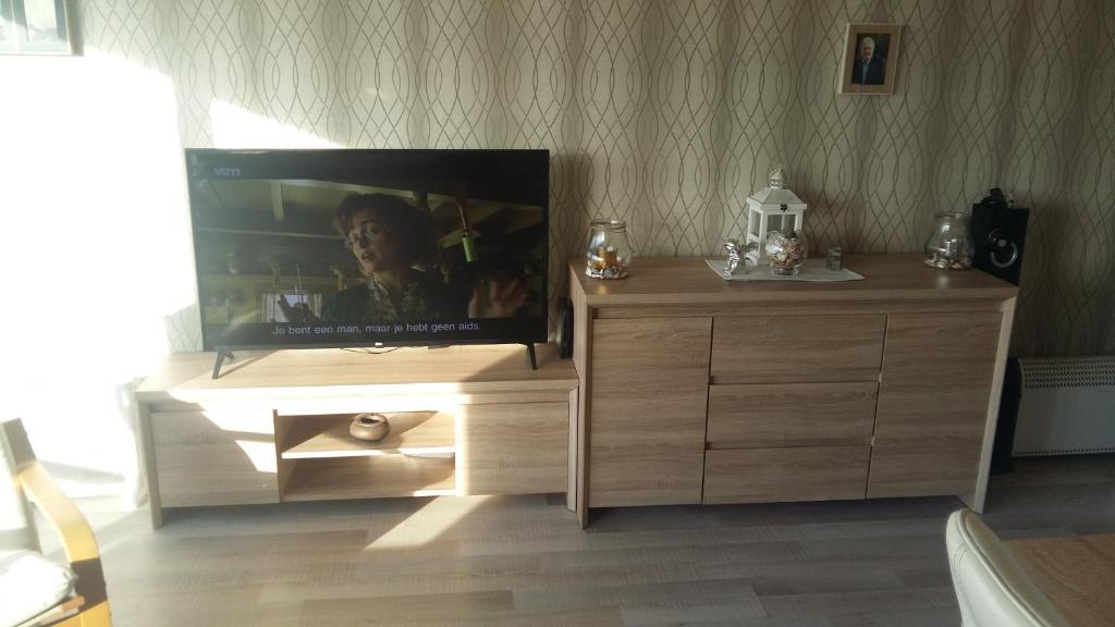 Télévision ou salle de divertissement dans l'établissement Residentie Astrid
