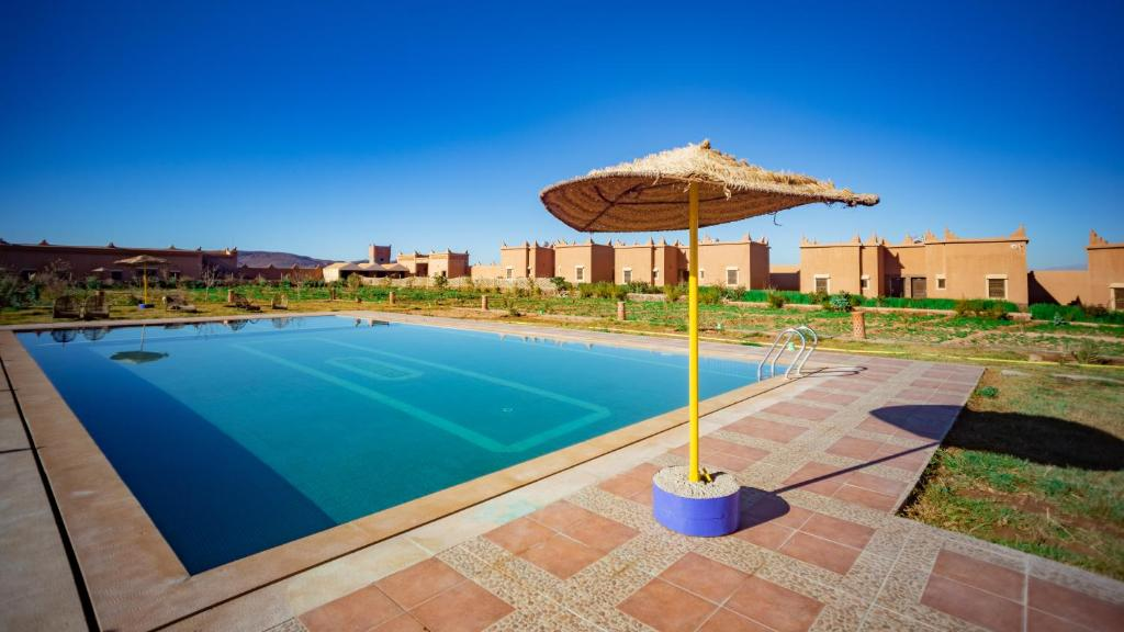 The swimming pool at or near Ecolodge l'île de Ouarzazate