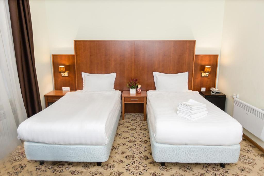 Кровать или кровати в номере Отель Матрешка