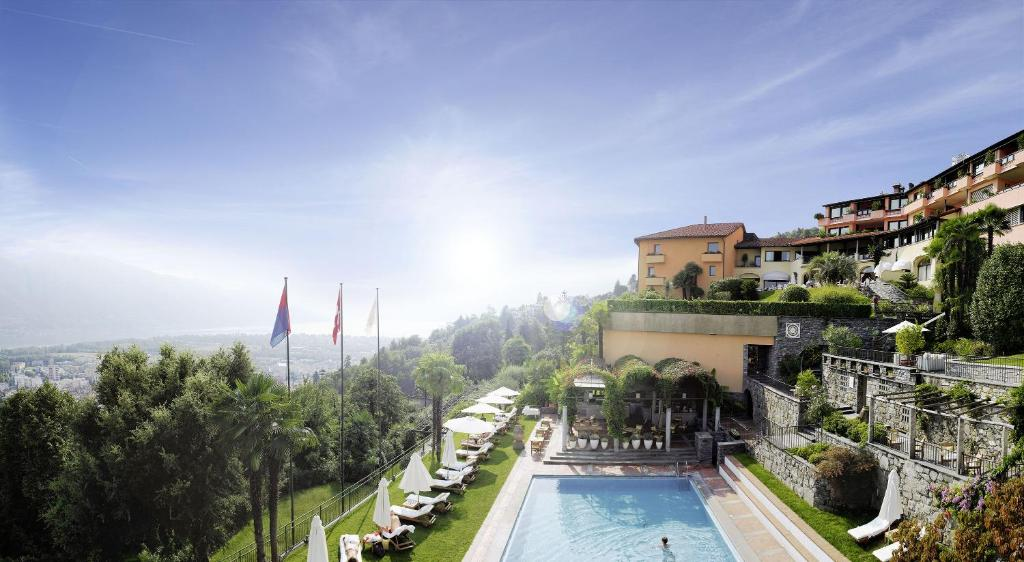 A view of the pool at Villa Orselina - Small Luxury Hotel or nearby