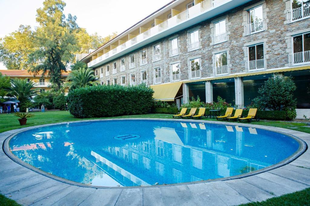 Majoituspaikassa Hotel Grao Vasco tai sen lähellä sijaitseva uima-allas