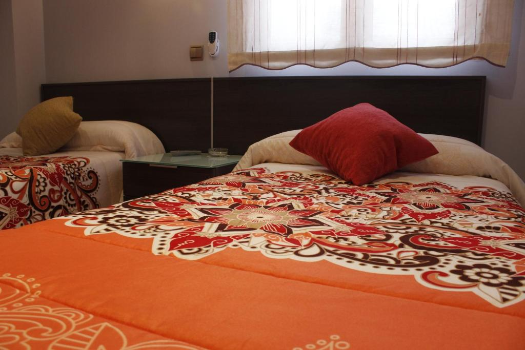 A bed or beds in a room at Pepe Campaspero