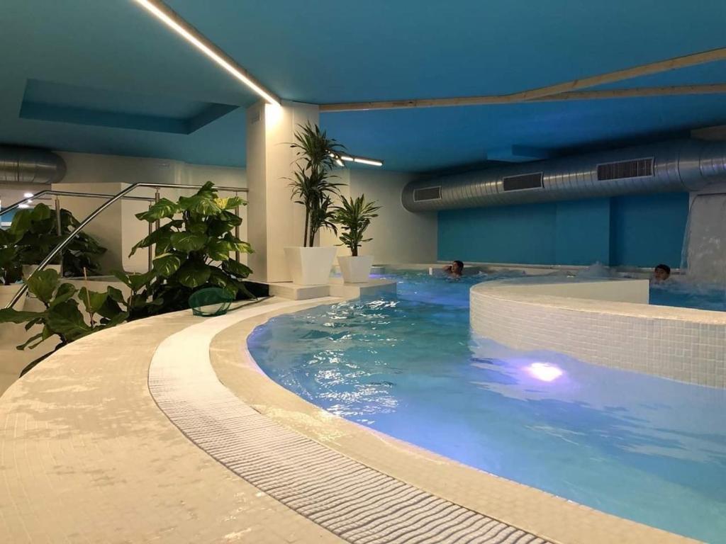 The swimming pool at or near Hotel Playa Langosteira