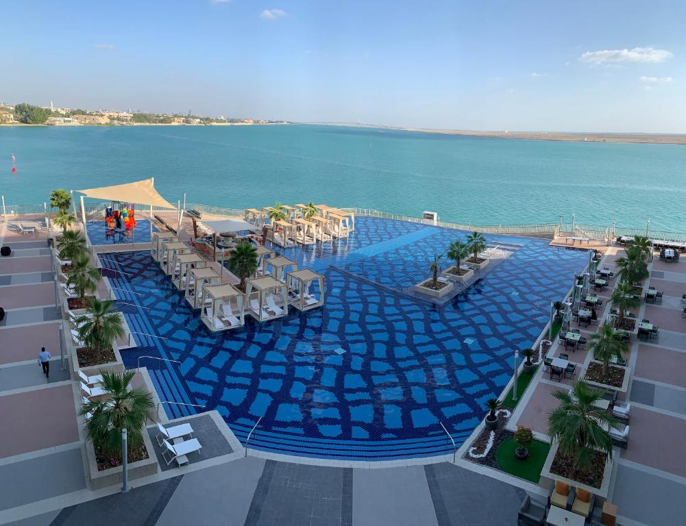 A view of the pool at Royal M Hotel & Resort Abu Dhabi or nearby