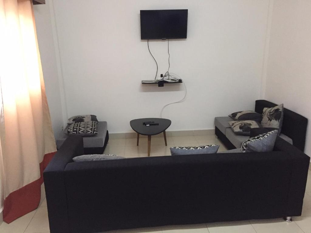 A seating area at Appartement Centre Ville