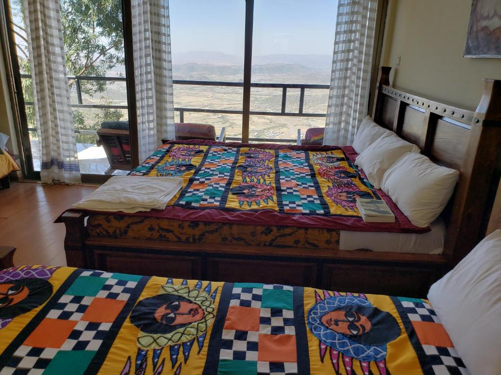 A bed or beds in a room at Top Twelve Hotel - Lalibela