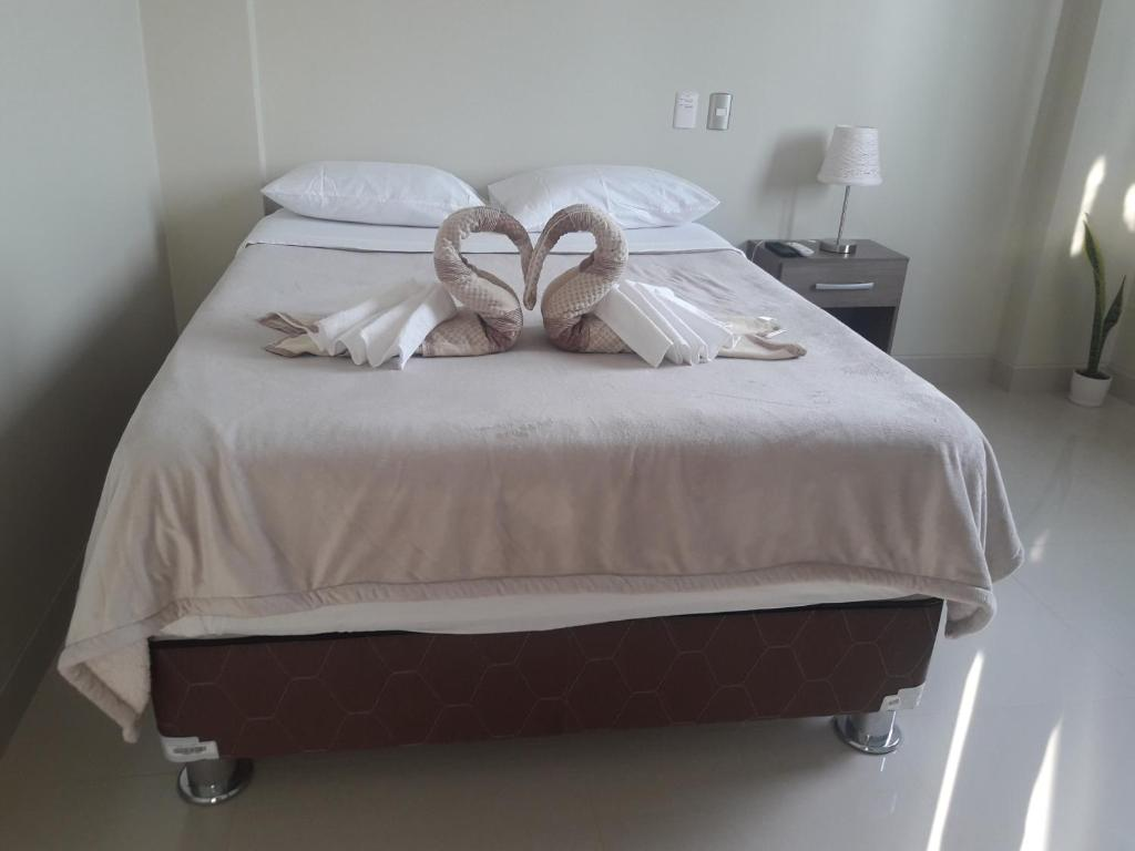 A bed or beds in a room at Willys House