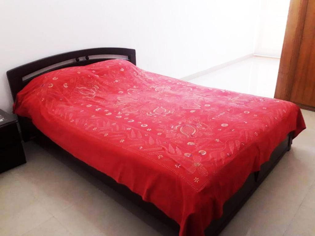 A bed or beds in a room at Drooty Homes