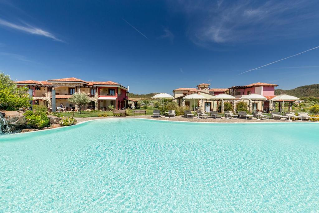The swimming pool at or near Hotel Sa Cheya Relais & Spa